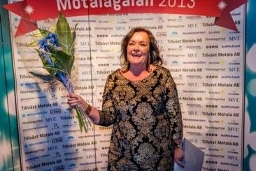 Mannie Gustavsson framför fotoväggen